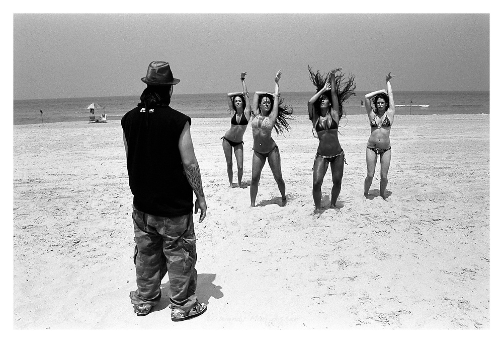 Dancers are rehearsing their routine for the video shoot of rapper Shi 360 on a beach. Rishon Lezion, Israel, 2007