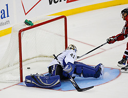 Nov 5, 2008; Newark, NJ, USA; New Jersey Devils right wing Jamie Langenbrunner (15) scores the game winner past Tampa Bay Lightning goalie Mike Smith (41) during the overtime period at the Prudential Center. The Devils defeated the Lightning 4-3 in an OT shootout.