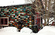 """SHOT 2/12/12 11:23:57 AM - Snow falls in front of the """"License Plate Home"""" in Crested Butte, Co. Crested Butte is a Home Rule Municipality in Gunnison County, Colorado, United States. A former coal mining town now called """"the last great Colorado ski town"""", Crested Butte is a destination for skiing, mountain biking, and a variety of other outdoor activities. The population was 1,529 at the 2000 census. The Colorado General Assembly has designated Crested Butte the wildflower capital of Colorado. The primary winter activity in Crested Butte is skiing or snowboarding at nearby Crested Butte Mountain Resort in Mount Crested Butte, Colorado. Backcountry skiing in the surrounding mountains is some of the best in Colorado. The mountain, Crested Butte, rises to 12,162 feet (3,700 m) above sea level..(Photo by Marc Piscotty / © 2012)"""