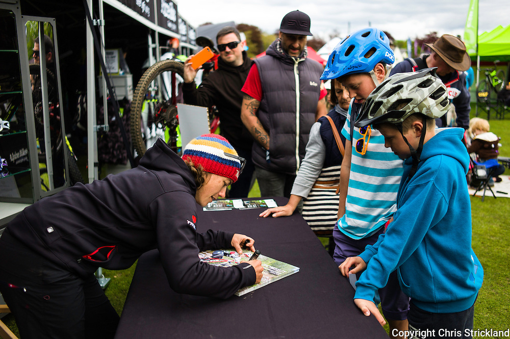 Innerleithen, Tweed Valley, Scotland, UK. 30th May 2015. Reigning Champion and current leader after Day One Tracy Mosley at an autograph signing session during The Enduro World Series Round 3 taking place on the iconic 7Stanes trails during Tweedlove Festival.