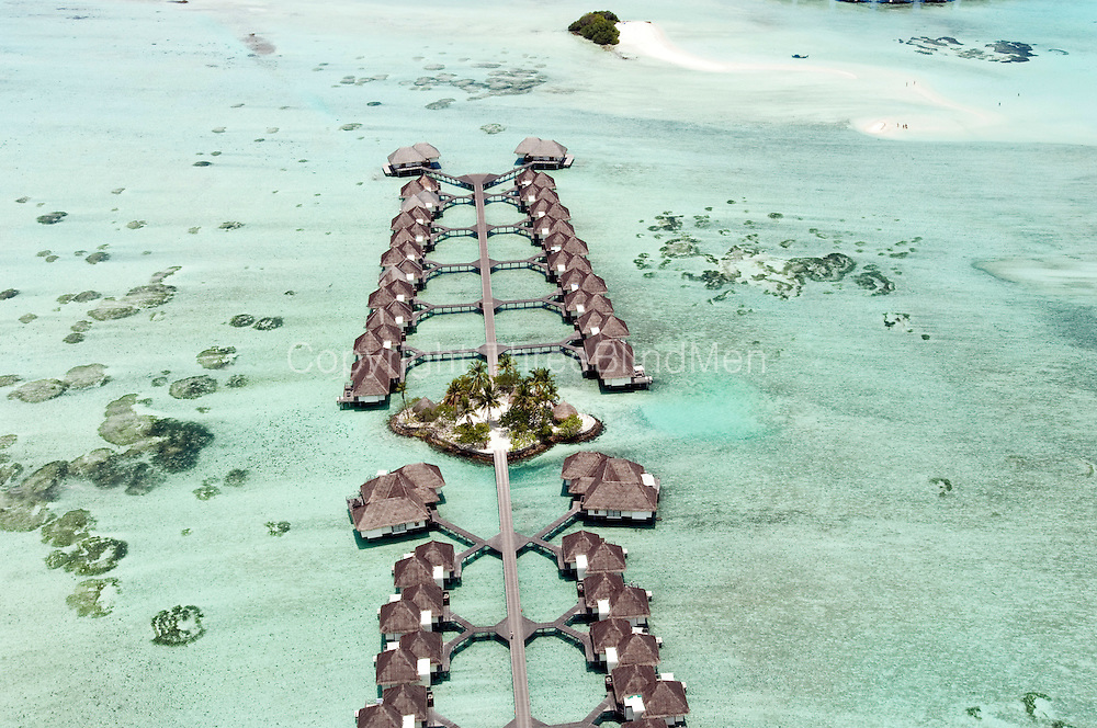 Maldives. The water bungalows of the Four Seasons hotel, Kuda Huraa. Aerial view.