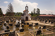 A flooded Serbian Orthodox cemetery in Samac, Bosnia and Herzegovina.<br /> <br /> Photo by Matt Lutton / Boreal Collective<br /> <br /> Flooding in Bosnia and Herzegovina.
