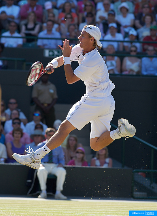 Lleyton Hewitt, Australia, in action against Andy Roddick, USA  during the Men's Singles Quarter Final Match at the All England Lawn Tennis Championships at Wimbledon, London, England on Wednesday, July 01, 2009. Photo Tim Clayton.