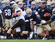 Linebacker Manti Te'o (5) gets his hands on Purdue Boilermakers quarterback Robert Marve (9) in the 2010 season opener.