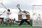 The women's lacrosse game between the UMBC Terriers and the Vermont Catamounts at Virtue Field on Saturday afternoon April 20, 2013 in Burlington, Vermont.