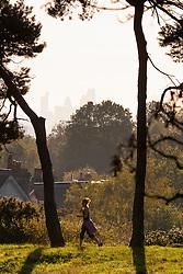 Hampstead Heath, London, October 28th 2014. A runner on Hampstead Heath enjoys the early morning sunshine.