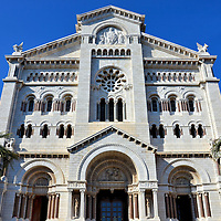 Saint Nicholas Cathedral Front Fa&ccedil;ade in Monte Carlo, Monaco  <br /> The first Saint Nicholas church to be built on &ldquo;The Rock&rdquo; was in 1252. It was replaced by the Cath&eacute;drale de Monaco in 1875.  It is called Saint Nicholas Cathedral. Technically, however, the name of this Roman Catholic church is the Cathedral of Our Lady of the Immaculate Conception.  A secondary patron saint is Saint Beno&icirc;t.  Benedict of Nursia lived in the 6th century and is also a patron saint of Europe and students. Their statues can be seen on either side of the cathedral&rsquo;s entrance.