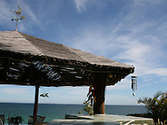 This beautiful palapa is offering hideaway under the warm Mexican sun, and also lets you enjoy fresh ocean breeze, watch the whales passing by, see dolphins playfully jump out of the water, or kite surfers passing by. <br /> Photo is part of a series of photographs of a beach front home in Los Barriles, Baja California Sur, Mexico.