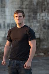 muscular man in a black tee shirt