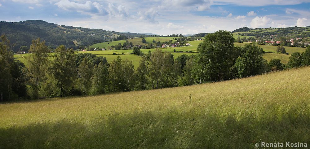 A wide view of a countryside at the foot of the Krkonose mountains, Czech Republic