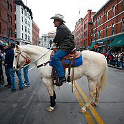 """SHOT 1/15/08 1:10:17 PM - Colorado Democratic governor Bill Ritter prepares to lead the National Western Stock Show Parade through the streets of Downtown Denver Tuesday January 15, 2007. The parade features a procession of cattle, horses and farm machinery through the streets of downtown Denver. The National Western Stock Show is held every January at the National Western Complex in Denver, Colorado. First held in 1906, it is the world's largest stock show by number of animals and offers the world?s only carload and pen cattle show in the historic Denver Union Stockyards. The stock show is governed by the Western Stock Show Association, a Colorado 501 (c) 3 institution, which produces the annual National Western Stock Show in an effort to forward the association's mission: """"To preserve the western lifestyle by providing a showcase for the agricultural industry through emphasis on education, genetic development, innovative technology and offering the world's largest agricultural marketing opportunities."""" The Super Bowl of livestock shows, National Western hosts 20 breeds of cattle, horses, sheep, swine, goats, llamas, bison, yak, stock dogs, poultry and rabbits. The 2008 National Western runs from January 12-27 this year..(Photo by Marc Piscotty / © 2008)"""