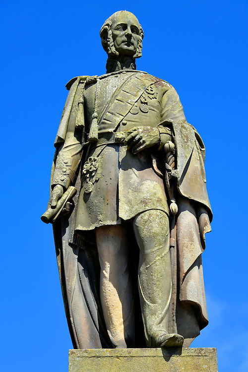 Charles Gordon-Lennox Statue in Huntly, Scotland <br /> Charles Gordon-Lennox (1791 &ndash; 1860) was the son of Charles Lennox, the 4th Duke of Richmond, and the nephew of George Gordon, the 5th Duke of Gordon. This resulted in Charles becoming the 5th Duke of Richmond and Lennox. He was an aide-de-camp (assistant) to Field Marshal Arthur Wellesley during the defeat of Napol&eacute;on Bonaparte at the Battle of Waterloo in 1815.  He was also the Postmaster General from 1830 until 1834. This bronze statue by sculptor Alexander Brodie was erected in The Square in 1862.