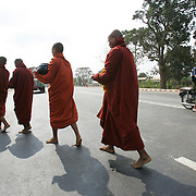 Buddhist monks walk on their morning rounds in the new capital of Naypyidaw.