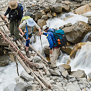 Our trekkers crossed a makeshift bridge over a stream near Deurali, Nepal. .Published in 2009 on Swedish trekking company site www.adventurelovers.se.