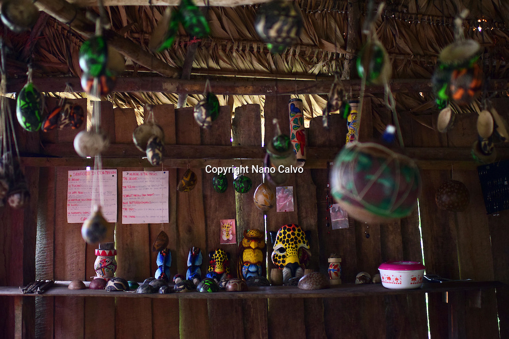 Assorted arts and crafts inside hut. <br />