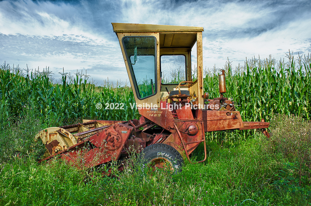 An abandoned harvester in a cornfield in Litchfield County,  Connecticut.