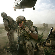 29/06/07..Sangin Valley, Helmand, Afghanistan..Soldiers from A Company 1 Battalion Royal Anglians, known as 'The Vikings' hunker down as a Chinook helicopter comes in to evacuate the injured from the frontline whilst conducting operations against the Taliban in the Sangin Valley, Helmand province, Afghanistan on the 29th June 2007...The soldiers made a Tactical Advance to Battle over night carrying just food, water and ammunition. At first light they moved on their objectives; a series of compounds, orchards and paddy fields. During the day they exchanged fire with the enemy on a number of occasions. 13 Taliban were killed, 1 British soldier and 3 Afghan troops were wounded.
