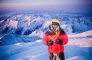 Alaska. Denali National Park. A hiker summits Mt McKinley (20,320 ft) at midnight in April.  MR