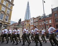 20131109       Copyright image 2013&copy;<br /> Seven Royal Marines cross the finish line in The Mall, London, welcomed by their comrades from Commando 999, as they  unofficially break the World Record for the Military Marathon, 26.2 miles carrying 40 pounds of weight. One member of the team of eight collapsed with exhaustion near the the finish line, which means that the record was not officially broken.<br /> The new world record is now  4 hours, xx minutes and xx secondsbeating the previous record which has stood for fifteen years.<br /> <br /> The Royal Marines completed the route around London starting at 4am.<br /> The world record marathon was run in conjunction with Commando 999, a fund raising charity for the Royal Marines Family.<br /> The previous world record was set in Luton in 1998.<br /> <br /> For further info please contact<br /> Alex Rayner - 07789 007232<br /> <br /> For further info please<br /> For photographic enquiries please call Anthony Upton 07973 830 517 or email info@anthonyupton.com <br /> This image is copyright Anthony Upton 2013&copy;.<br /> This image has been supplied by Anthony Upton and must be credited Anthony Upton. The author is asserting his full Moral rights in relation to the publication of this image. All rights reserved. Rights for onward transmission of any image or file is not granted or implied. Changing or deleting Copyright information is illegal as specified in the Copyright, Design and Patents Act 1988. If you are in any way unsure of your right to publish this image please contact Anthony Upton on +44(0)7973 830 517 or email: