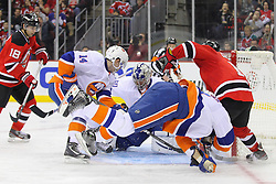 Jan 31, 2013; Newark, NJ, USA; New Jersey Devils right wing Steve Bernier (18) scores a goal on New York Islanders goalie Evgeni Nabokov (20) during the second period at the Prudential Center.