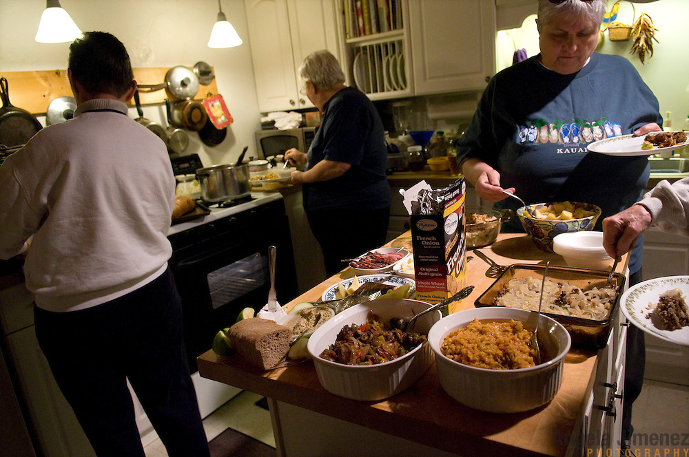 """Date: 1/08/09.Desk: STL.Slug: WOMYN.Assign ID: 30074969A..Women gather for a potluck dinner at Alapine, a """"womyn's land"""" or lesbian intentional community, in rural northeast Alabama. Pictured are, from left, Jean Adele, 72, Mary, 63, (*her last name cannot be used), and Barbara Moore, 63. The potluck was held in the home Mary shares with her long-time partner.  ..(*the exact town/location of the community cannot be revealed in the caption or article, per agreement with the subjects)..Photo by Angela Jimenez for The New York Times .photographer contact 917-586-0916."""