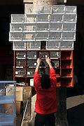 A man rearranges some of his bird cages, in the main square in Bilbao's Casco Viejo (old town)