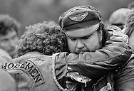 Jack (Henchman Bear) Schmidt, the new president of the Iron Horseman, comforts another club member at the graveside.<br /> Funeral service for Robert (Moose) Holston, 27, Kentucky chapter president of the Iron Horseman motorcycle club.  He was buried by his club members at a &quot;cycle funeral&quot; at St. Stephens Cemetery in Ft. Thomas, KY.  Holston was stabbed to death during a fight at the headquarters of the Seventh Sons motorcycle club in Newport, KY.  About 500 cyclists from Kentucky, Ohio and Indiana attended the funeral.
