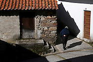 """An old woman walks by Lazarim village during the traditional Celtic carnival """"Caretos"""" in the village of Lazarim, central Portugal on February 17, 2015. PAULO CUNHA /4SEE"""