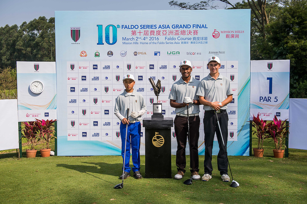 Tom Parker of New Zealand, Arjun Prasad of India and Xi Pu of China poses for a picture with the trophyin action during day one of the 10th Faldo Series Asia Grand Final at Faldo course in Shenzhen, China. Photo by Xaume Olleros.