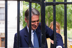London, August 20th 2014. Foreign Secretary Philip Hammond MP arrives at Downing Street for talks with the PM, who cut short his Cornwall holiday, on security issues related to the execution, by a Jihadists from ISIL who had what appears to be a British accent, of American journalist James Foley.