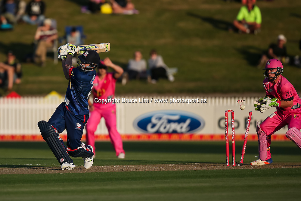 Auckland Aces' Colin Munro is bowled by Knights' Ish Sodhi during the McDonalds Super Smash T20 cricket match - Knights v Aces played at Seddon Park, Hamilton, New Zealand on Saturday 17 December.<br /> <br /> Copyright photo: Bruce Lim / www.photosport.nz
