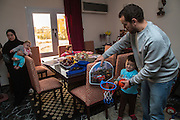 CAIRO, EGYPT - FEBRUARY 25: Al Jazeera English (AJE) producer Baher Mohamed enjoys family time with son Hazem, wife Jihan (l), infant son Haroun, and daughter Fairouz February 25, 2015 at his family apartment in the Sheikh Zayed district on the outskirts of Cairo, Egypt. Baher, and fellow Al Jazeera defendent Mohamed Fahmy were conditionally released on Feb 12, 2015 following Egypt's highest appeal courts decision to grant them a retrial, which has since been postponed until March 8. (Photo by Scott Nelson, for the Washington Post)