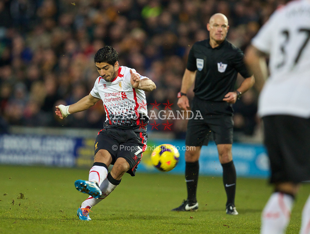 HULL, ENGLAND - Sunday, December 1, 2013: Liverpool's Luis Suarez takes a free-kick against Hull City during the Premiership match at the KC Stadium. (Pic by David Rawcliffe/Propaganda)