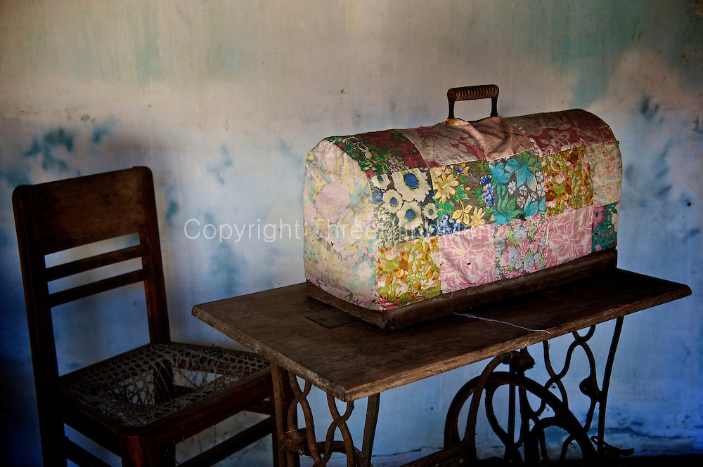 Sabapathy House. Vaddukodai, Jaffna.<br /> Interior of a tradition Natcharam home in Vattukkottai. <br /> Sewing machine with patchwork cover. <br /> Jaffna homes. 2011