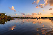 A kayaker paddles at sunset across the tranquil surface of Hidden Lake near the western shore of Biscayne Bay in Miami, Florida.<br /> WATERMARKS WILL NOT APPEAR ON PRINTS OR LICENSED IMAGES.