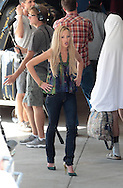 "August 14th 2012 Burbank, CA ***EXCLUSIVE*** David Cross & Portia de Rossi film film a scene for the cult hit Television show, ""Arrested Development"" which last aired in 2006. Six years after being cancelled a fourth season has now begun filming for Netflix. The first scene to be filmed took place at the Burbank Airport with original cast members David Cross & Portia de Rossi . The Burbank Airport doubled for an airport in India with actor David Cross wearing  a Humorous version of the Sari. Photo by Eric Ford/ On Location News 818-613-3955 info@onlocationnews.com"
