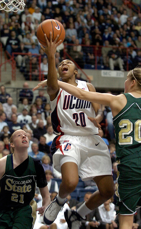 Connecticut's Renee Montgomery, left, goes up for two points while guarded by Colorado State's Molly Nohr, right, in the second half of a college women's basketball game in Storrs, Conn., Thursday, Dec. 21, 2006.  At left is Colorado's Emily Neal. (AP Photo/Jessica Hill)