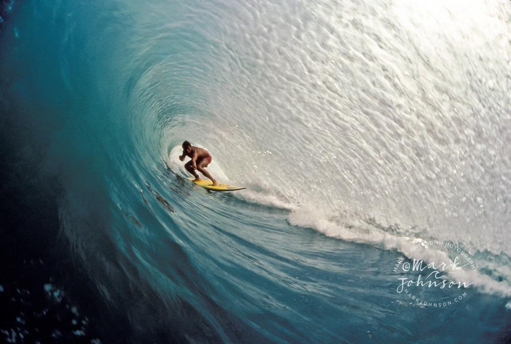 Surfer deep in a Bali tube, Kuta Beach, Bali, Indonesia