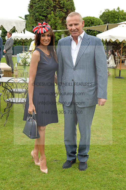 JACKIE ST.CLAIR and CARL MICHAELSON at the Goffs London Sale held at The Orangery, Kensington Palace, London on 12th June 2016.