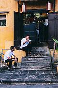 Restaurant workers taking a break, Hoi An, Vietnam