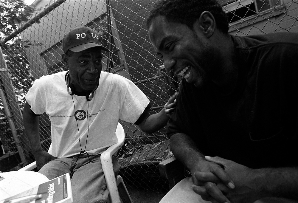 "Tyron Gamble, right, gets advice from a ""veteran"" of the Seattle streets. Camble had just arrived in Seattle on a bus ticket provided by the State of Florida, where he was just released from penitentiary."