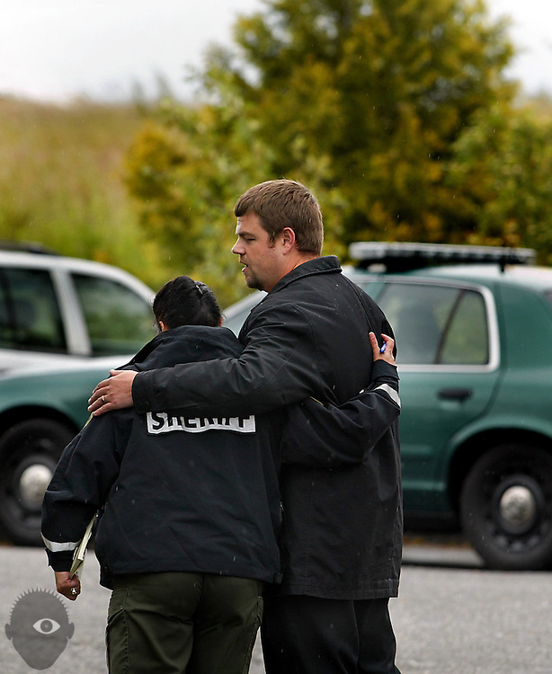 06/09/10 -   (LtoR) Lieutenant Mary Lindstrand, a spokesperson for the Multnomah County Sheriff's Office and Skyline Elementary School principal Ben Keefer hug following another press conference for missing student 7-year-old Kyron Horman. Another press conference at the Brooks Hill Historic Church yielded few new details. though a statement from the parents was released.8