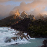 A small cascade overshadowed by the brilliance of a Patagonian sunrise in Southern Chili