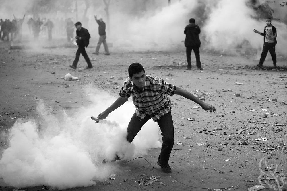 An Egyptian protestor hurls a tear gas canister back towards the police who shot it during ongoing demonstrations November 20, 2011 near Tahrir square in central Cairo, Egypt.  Protestors demanding the transition of power from the military to civilian control clashed with Egyptian security forces for a second straight day in central Cairo, with hundreds injured and at least 11 protestors killed.  (Photo by Scott Nelson)