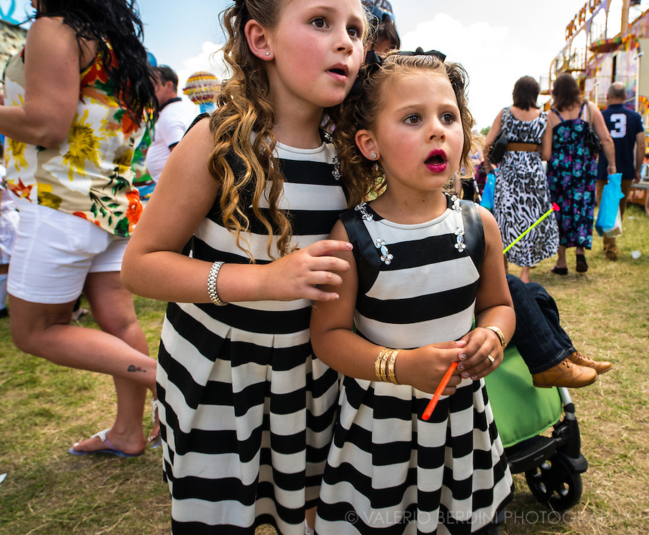 Two little sisters wear the same dress.