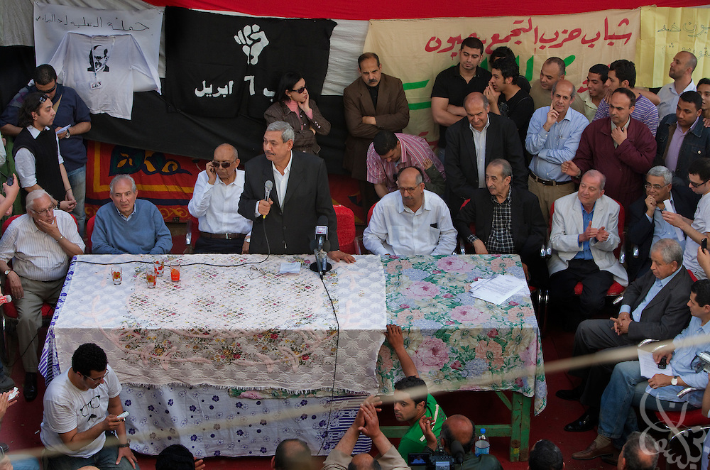 A group of local Egyptian politicians and political analysts welcome Egyptian Nobel Peace laureate and former UN atomic watchdog chief, Mohamed ElBaradei (seated to right of man with microphone) during a brief stop in the Egyptian delta town of Aga on April 2, 2010. ElBaradei is thought to be a possible candidate to run against Egyptian President Hosni Mubarak in the 2011 presidential election, although he has not made a formal declaration as of yet.