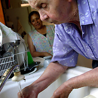 An Alzheimer's patient wahes her hands at a live-in residence for Alzheimer's and dementia related  patients.