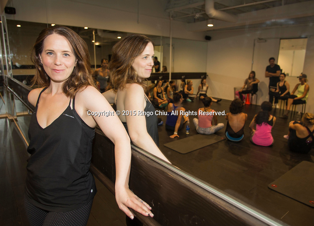 Jennifer Williams, co-founder of bar fitness studio Pop Physique in downtown Los Angeles.<br /> Photo by Ringo Chiu/PHOTOFORMULA.com)