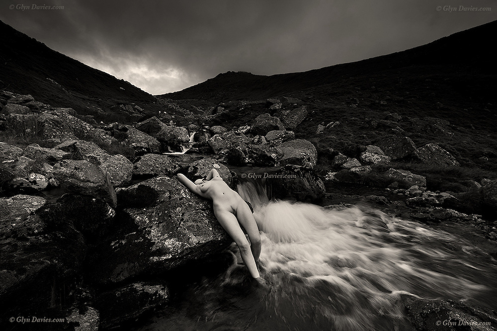 &quot;Landscape Figures&quot; Believable nudes in wild landscape<br /> <br /> A major new exhibition, &ldquo;Landscape Figures&rdquo;<br /> <br /> In 2011, the British Prime Minister catapulted professional landscape photographer, Glyn Davies, into the limelight after purchasing two of Glyn&rsquo;s books as a personal gift for the Royal wedding of the Duke and Duchess of Cambridge. What people did not know at this time is that Glyn had started working in his free time on a three year major project dealing with the subject of fragility and vulnerability of the naked human form in wild landscape.<br /> <br /> The models are inexperienced volunteers from the general public, not photographic models, and they were asked to pose completely naked, all forms of protection removed, clothes, boots and equipment so that they became exposed physically and mentally to the elements, but sensually connected to the earth and nature. Glyn said, &quot;I mostly wanted to place the exposed figures within bigger spaces but sometimes there was a need to place them in more intimate, closer landscapes&quot;<br /> <br /> &quot;Although the nude is vital to the project and an integral element of the images, they are not really 'nude' photographs - they are landscapes, given a greater sense of scale, drama and power by the inclusion of the human form, a form which in some cases you will need to look hard to find!&rdquo;