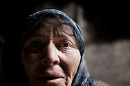 SYRIA, Idlib province, Taftanaz:  A Syrian woman who lost two sons that were killed by Al Assad forces, is seen inside her burned house, on April 11, 2012. ALESSIO ROMENZI